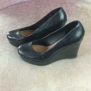 Black leather Aldo platform wedges, size 7.5
